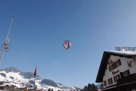 Balloon flying over the Alps in a Swiss resort.