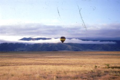 A hot air balloon flight in Africa over dry savannahs and lush rainforests.