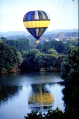A hot air balloon flight will take you over a new path each time, allowing you to see new sites such as this beautiful lake.