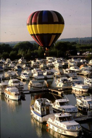 A hot air balloon flight will take you over a new path each time, allowing you to see new sites such as this harbour.
