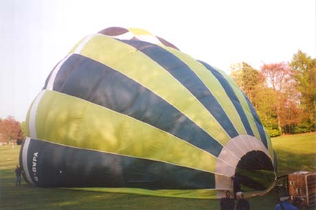 A half inflated hot air balloon envelope.