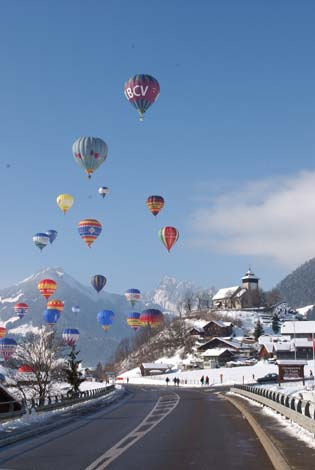 Another Alpine hot air ballooning photo, this time of a great swarm of balloons all taking off together.