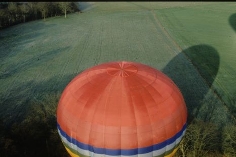 A hot air balloon envelope as seen from another balloon above..