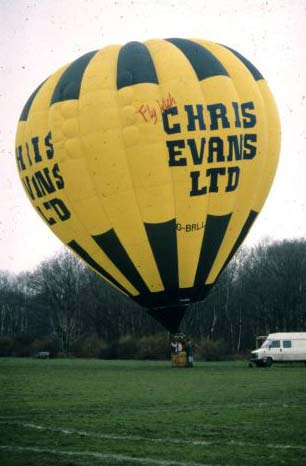 A fully inflated hot air balloon, ready for take off.