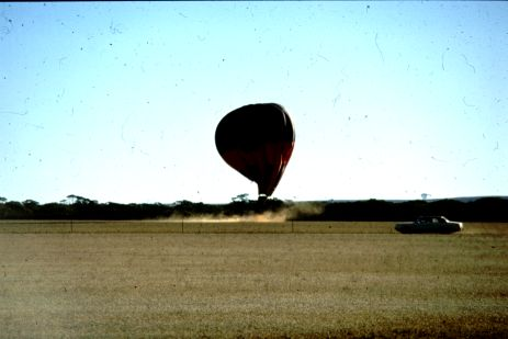 Photograph of a high speed hot air balloon landing.