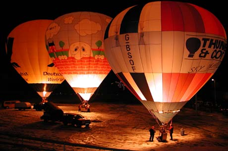 The nightglow from three hot air balloons.