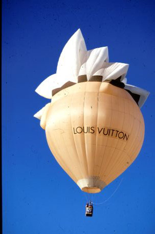 A hot air balloon shaped as the Sydney Opera House.