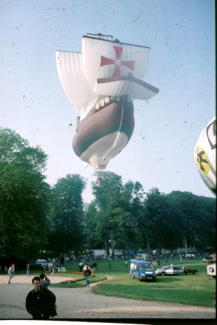 A hot air balloon shaped as a pirate ship is in the air.