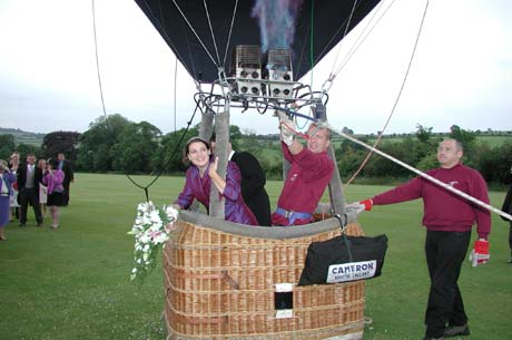 The happy couple enjoying a hot air balloon wedding flight.
